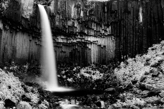 Photo: This is Svartifoss, an iconic waterfall located in the Skaftafell mountains in Iceland. I have photographed it on several occasions but lately I really like this IR look so will go with this one today. It was shot with a regular DSLR but there was so much green around that it was very easy to achieve this look. I am now converting one of my cameras to IR so expect many more of these. Enjoy and share.  #monochromemonday #BWFineArtLE #moodymonday #mountainmonday #FineArtPls #beautifulmundanemonday #PlusPhotoExtract #potd #BreakfastClub #breakfastartclub #photography #NatureMonday