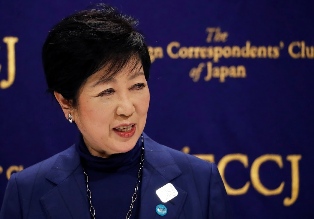 Tokyo governor asks bars, restaurants to shut early amid Covid-19 spike