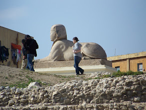 Photo: Stone statue and random Asian tourist.
