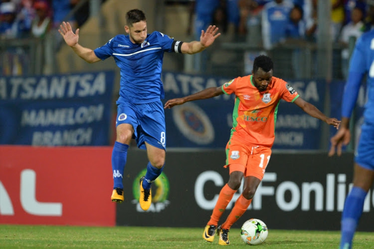 SuperSport United captain Dean Furman and John Chingandu of Zesco United during the CAF Confederations Cup match at Lucas Moripe Stadium on September 15, 2017 in Pretoria, South Africa.