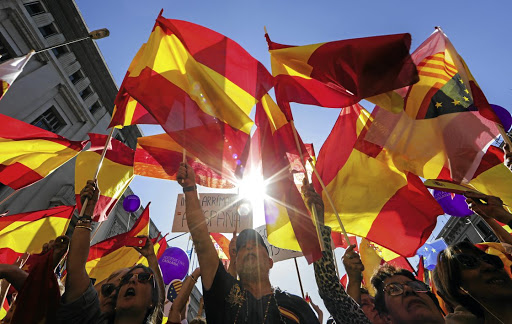 Calls for unity: People wave Spanish flags during a pro-union demonstration in Barcelona, Spain on Sunday. Picture: REUTERS