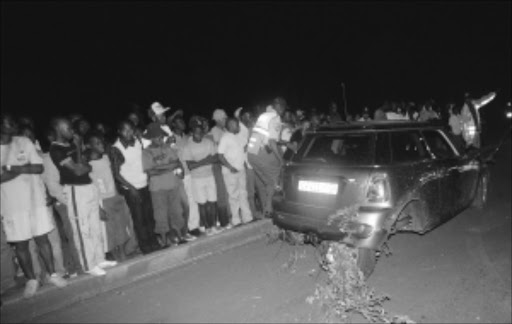 A Mini Cooper owned by Hip Hop artist Jub Jub was involved in a drag race accident in Protea North, Soweto killing four school children instantly. PIC: BAFANA MAHLANGU. 09/03/2010. © Sowetan.