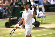 Novak Djokovic of Serbia celebrates in his Men's Singles semi-final match against Roberto Bautista Agut of Spain during Day eleven of The Championships - Wimbledon 2019 at All England Lawn Tennis and Croquet Club on July 12, 2019 in London, England.