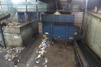 Photo: Red bin waste sorting of glass, aluminum and plastics