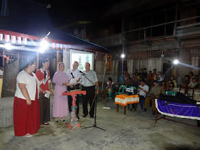 Photo: Thursday evening found us at still another mountain village...at Hari Keempat village. This was also an open air meeting by the village community center with most of the village attending the service. Here we are singing as a team once again.