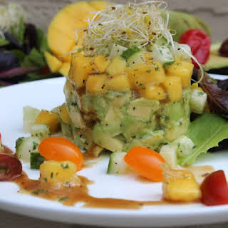 Chef Noel Cunningham Mango, Avocado & Cucumber Salad with Scotch Bonnet – Balsamic Herb Vinaigrette.