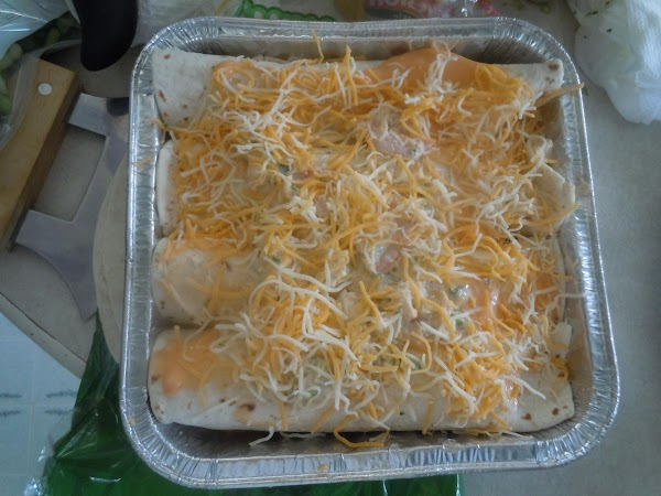 Top with Cream of Shrimp Soup and cheese. Cover with foil and bake for...