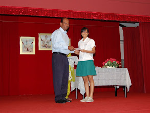 Photo: Lathigha Namiar receiving the Excellence Award. She did well in O Level.