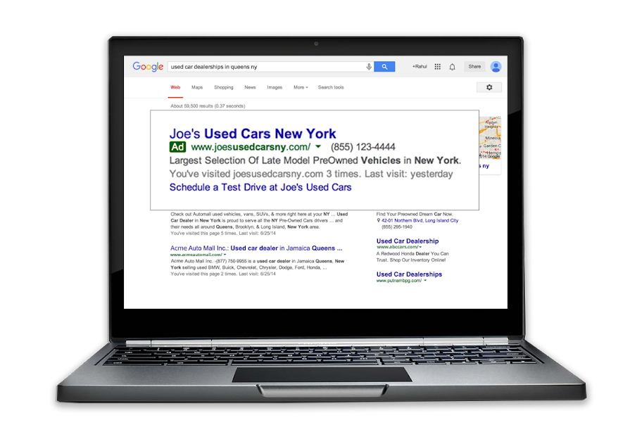 Example of an ad with dynamic sitelinks on a laptop.