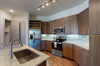 Gourmet kitchen with wood cabinets and stainless steel appliances