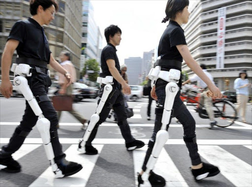 Japan's robotics venture Cyberdyne employees wearing the robot-suit