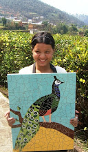 Photo: Rina with the completed peacock that Aline commissioned!