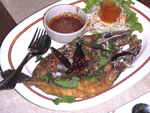 "Photo: fried snakehead fish topped with hot-and-sour seasoned herbs and toasted rice (""laab pla chon"") at Ton Kreuang in Bangkok"
