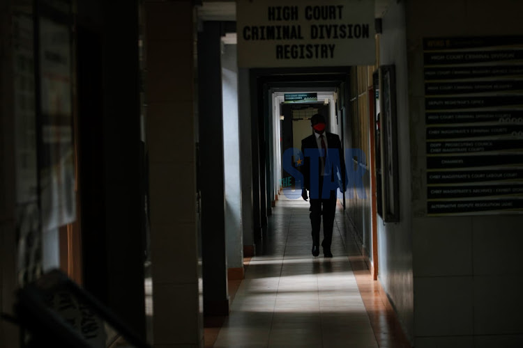 A man walks along the corridors of the Milimani courts on June 15, 2020.