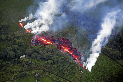 Lava spews from a fissure east of the Leilani Estates subdivision during eruptions of the Kilauea volcano in Hawaii, on May 13 2018. Picture: REUTERS