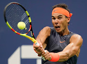Rafael Nadal of Spain hits to Dominic Thiem of Austria in a quarterfinal match on day nine of the US Open tennis tournament at USTA Billie Jean King National Tennis Center September 4 2018 in New York.