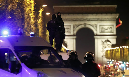 Masked police stand on top of their vehicle on the Champs Elysees Avenue in Paris on April 20 2017, after a policeman was killed and two others wounded in a shooting claimed by Islamic State. Picture: REUTERS
