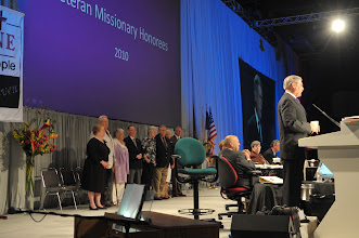 Photo: President Kieschnick introduced each veteran missionary honoree couple to the Convention. LCMS veteran missionaries have been honored before the Synod Convention since 1995.