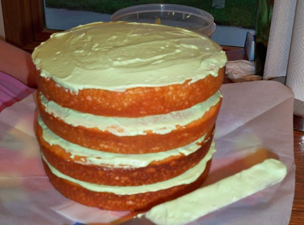 Once cakes are cooled, start with first layer. Spread a small amount of frosting...