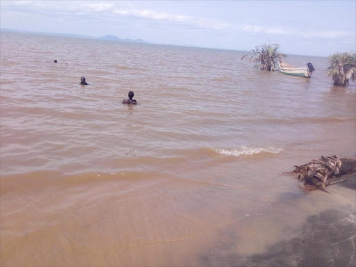 Fishermen at the shores of Lake Turkana on 11 July, 2018 /HESBOUN ETYANG