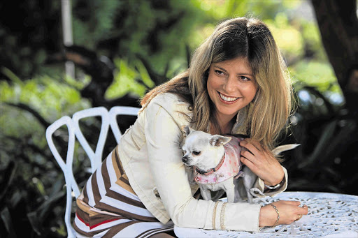 Heart and double lung transplant recipient Tina Beckbessinger relaxing with her dog Chloe