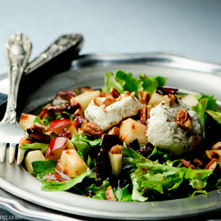 Pear Salad with Dried Cherry Vinaigrette and Macadamia Nut Medallions.