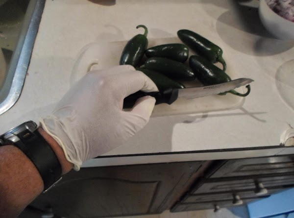 Meanwhile, start chopping jalapenos, (use rubber cloves to chop jalapeno peppers).