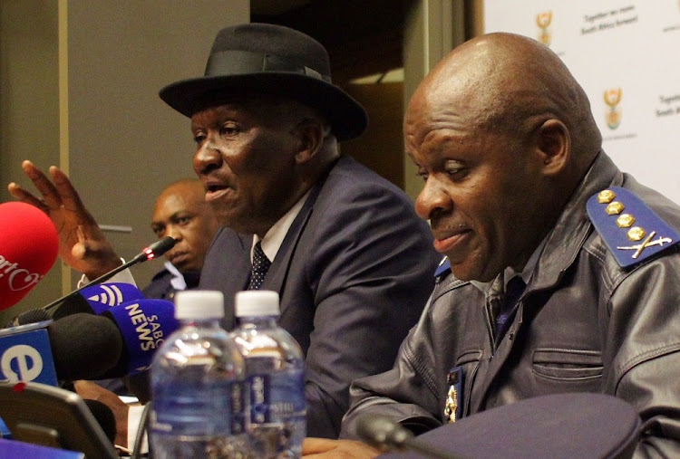 Police minister Bheki Cele and national police commissioner Khehla Sitole addresses the media at parliament in Cape Town during the annual SAPS crime statistic results.