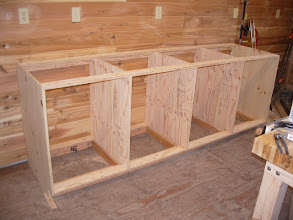 Photo: With the cabinet built and then rolled onto the base. As with the miter bench, the ends are knotty pine and extend to the floor.