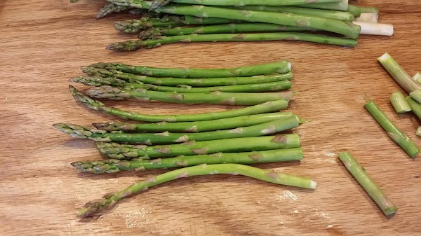 Clean asparagus by rinsing well in cool water.  Hold bottom of stalk and...