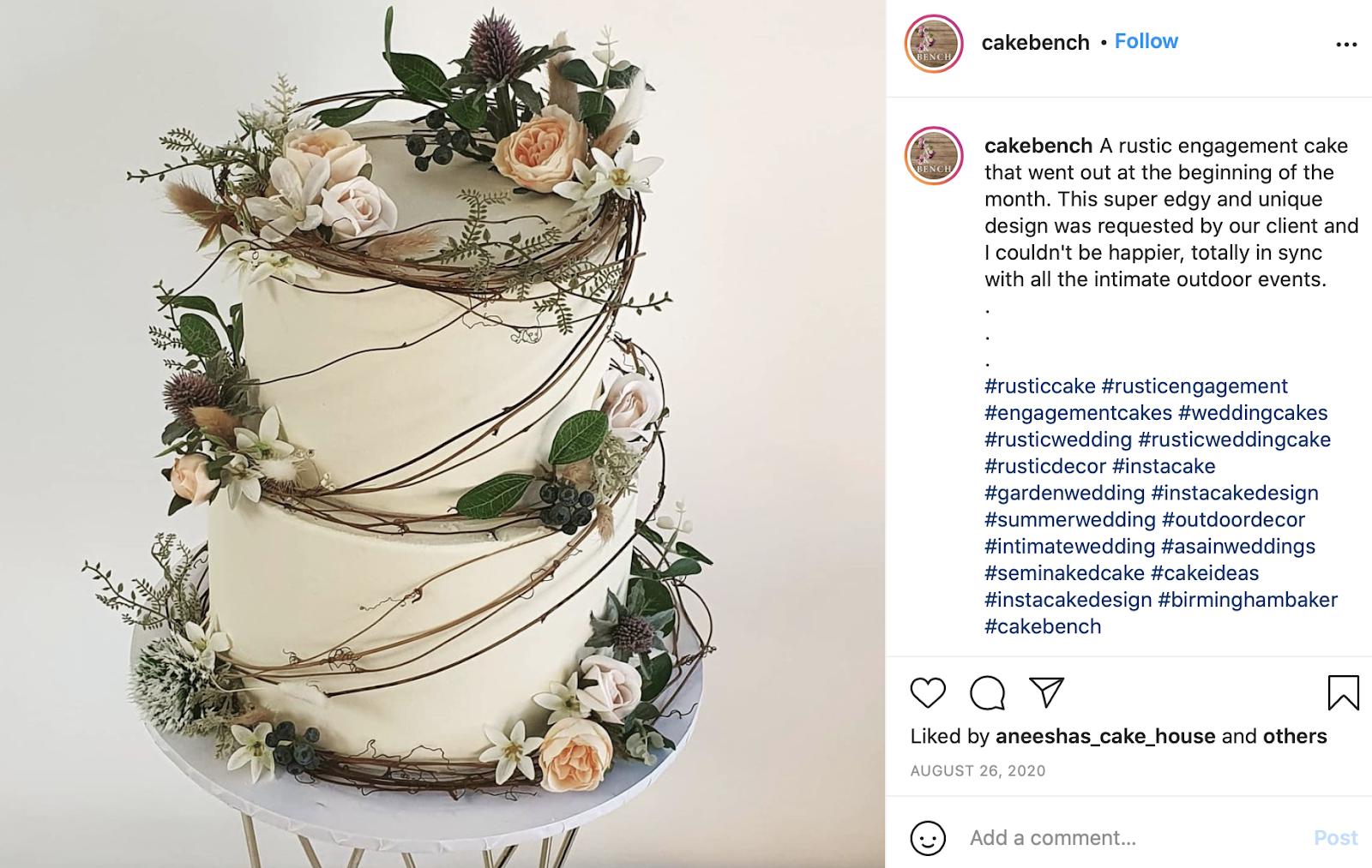 Plain White Wedding Cake With Greenery
