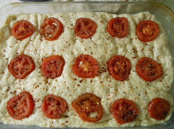 Place pan roasted tomatoes on top of dough.  Sprinkle with red pepper flakes....