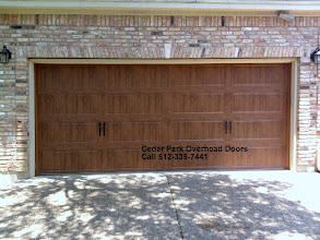 Photo: Clopay Carriage House Door. Long Panel Light Oak Fuax wood colors