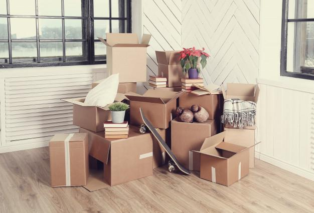 Moving home with cardboard boxes Free Photo