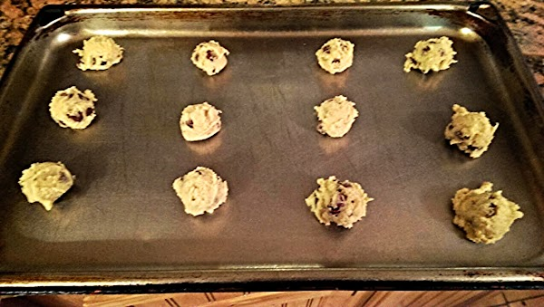 SPRAY PAN AND USING A ONE INCH COOKIE SCOOP, PLACE COOKIE DOUGH TWO INCHES...