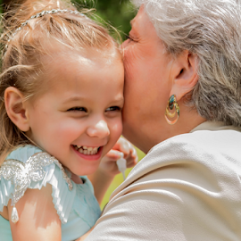 Grandmother and Grand-daughter  by Janice Mcgregor - Wedding Reception ( canon, grand-daughter, wedding photography, hugs, wedding, grnadmother, canon sl1, embrace, flower-girl, smiles, outside,  )