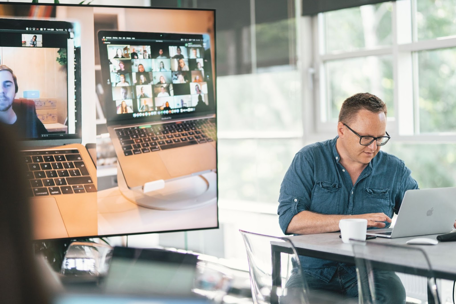 A man engaged in a team video call