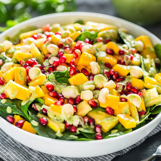 Tropical Spinach Salad with Creamy Coconut Lime Dressing.