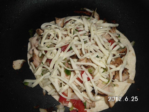Slice grilled chicken, grated cheese.  Heat a skillet or griddle to hot, spray...