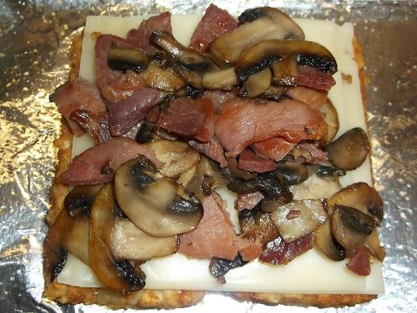Mix ham and mushrooms together, then spoon 1/2 on top of the cheese; return...