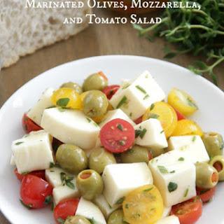 Marinated Olives, Mozzarella, and Tomato Salad.