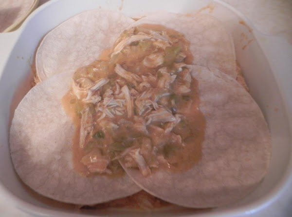 Place 4 tortillas in the bottom of a 2-quart casserole coated with cooking spray....
