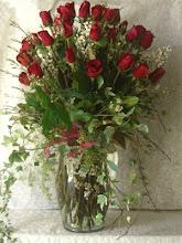 Photo: Two Dozen Roses in glass vase, $125.00.