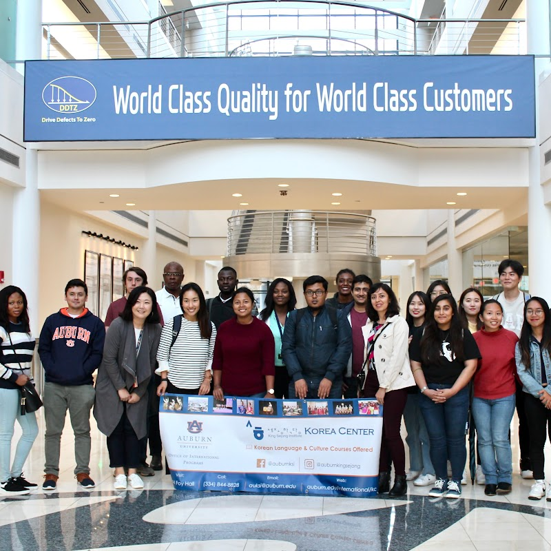 Students pose in the lobby of the Hyundai Plant in Montgomery