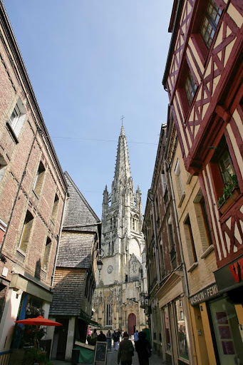Stroll the narrow streets of Harfleur, France, with the towering cathedral as a guidepost.