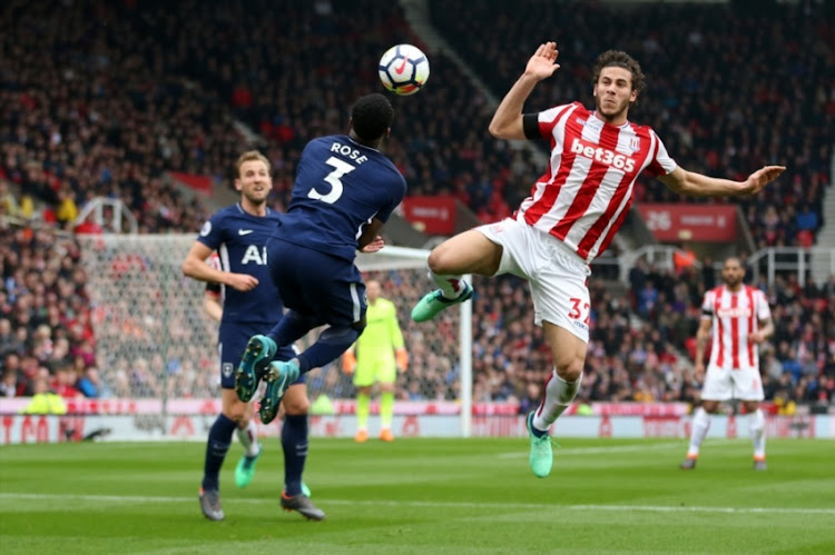 Danny Rose of Tottenham Hotspur and Ramadan Sobhi of Stoke City during the Premier League match between Stoke City and Tottenham Hotspur at Bet365 Stadium on April 7, 2018 in Stoke on Trent, England.