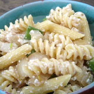 Ricotta Pasta with Snap Peas and Caramelized Onions.