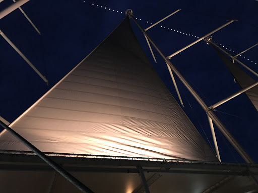 wind-surf-sails-at-night.jpg - Sails spotlit in the evening breeze on Wind Surf.