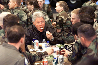 Photo: United States President Bill Clinton has dinner with the troops of Ramstein Air Base late 05 May 1999, during his visits to a variety of US Military bases that provide support for the US Military effort in and around Kosovo. AFP PHOTO FILES/PAUL J. RICHARDS (Photo by: AFP/Getty Images/ PAUL J. RICHARDS)