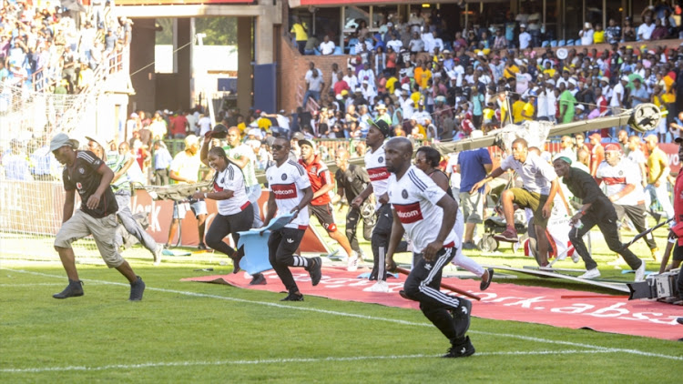 Orlando Pirates supporters on the rampage during the Absa Premiership match against Mamelodi Sundowns at Loftus Versfeld Stadium on February 11, 2017 in Pretoria, South Africa.